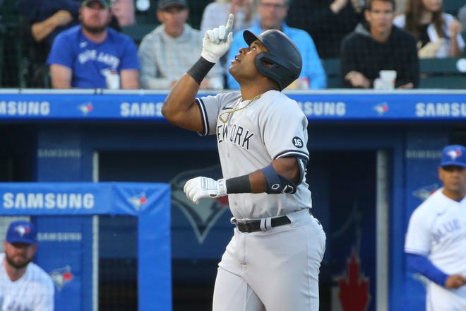 New York Yankees first baseman Chris Gittens celebrates his home run during the fourth inning of a 6-5 victory over the Toronto Blue Jays in Buffalo, N.Y. It was the Sherman native's first career major league hit.