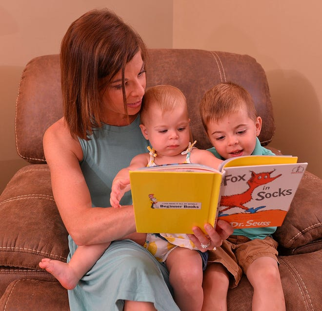 Lauren Griffin reads with her daughter Cayleigh, 15 months, and son Carson, 3, at the family's home in Moore, Wednesday, June 16, 2021.