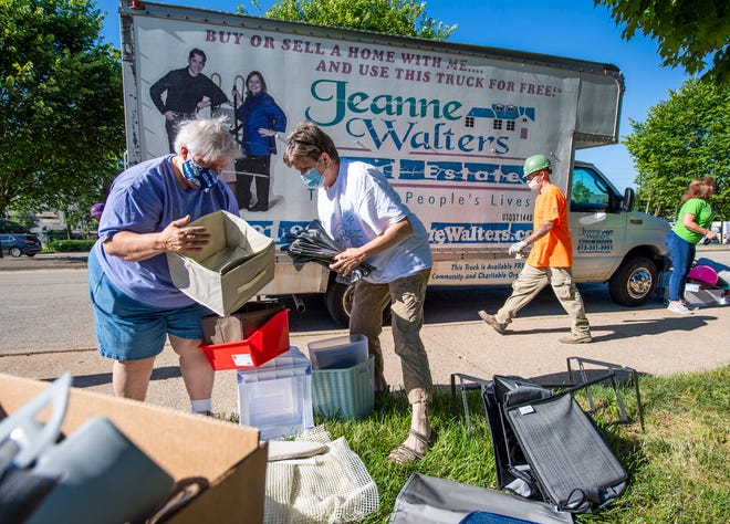 Phyllis Wickliff, left, and Louise Briggs, center, look over items left behind by students at McNutt Quadrangle Wednesday for both New Hope for Families and the Shalom Community Center during the Hoosier to Hoosier Partnership program.
