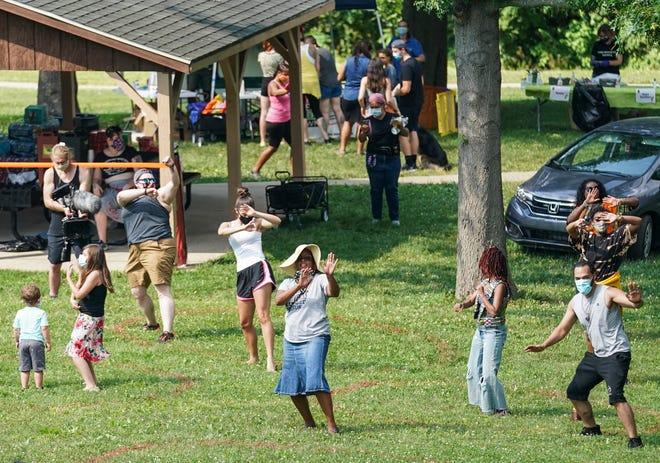 Juneteenth celebration attendees dance during a celebration hosted by Black Lives Matter of Bloomington in Rev. Ernest D. Butler Park in 2020.