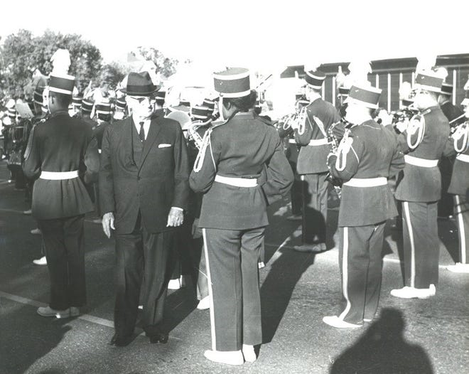 President Harry S. Truman inspects the Hutchinson Parade Band on Oct. 22, 1962