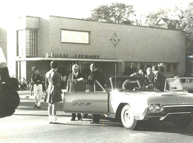 President Harry S. Truman prepares to ride in a new Thunderbird for a Hutchinson City Parade on Oct. 22, 1962.