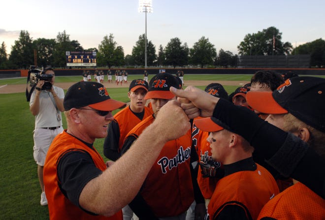 Coach Kevin Brown, left, high fives his players after they won the Urbana Supersectional in June 2007.