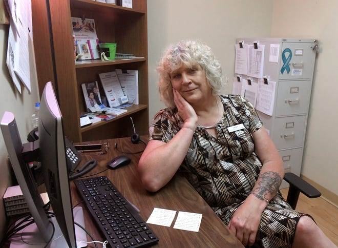 Dana Garber, Transgender Intake Coordinator and Community Educator, sits in her office at Planned Parenthood in Peoria recently.