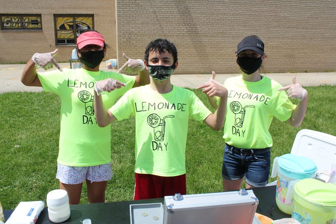 Lincoln Elementary students proudly show off their Lemonade Day T-shirts.