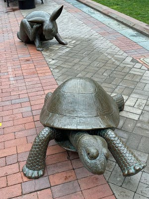 The Tortoise and the Hare bronze sculpture can be found near the Boylston Street – Dartmouth Street intersection in Copley Square. It was created by Nancy Schon and installed in 1994. It's from the Aesop's Fable story about how the slow-moving tortoise outraced the faster hare. The sculpture, which is near the Boston Marathon finish line, honors the runners from across the world who have taken part in one of the most well-known races.