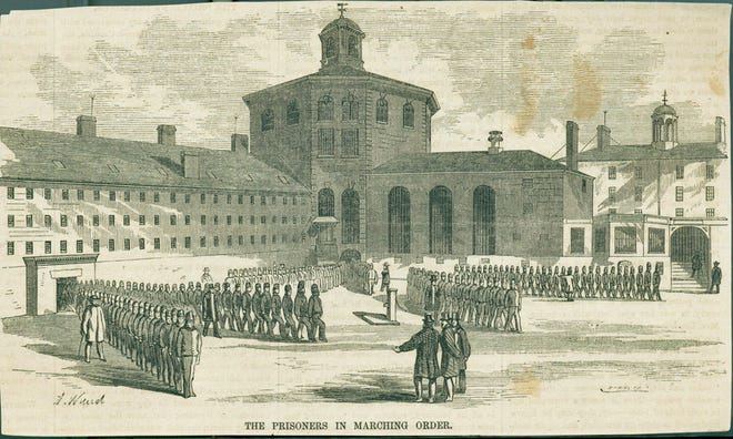 This print from the 19th century shows prisoners at the Massachusetts State Prison in Charlestown marching with officials watching. Official-looking men in top hats stand in front of the groups of men. Learn more from Digital Commonwealth at www.digitalcommonwealth.org.