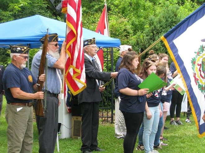 Members of the Boyce-Houser Post 41 American Legion post the colors while members of the Burlington United Methodist Family Services Girls Rainbow Choir sing the National Anthem to open the Gold Star Mothers Memorial Tree Planting Sunday at Larenim Park.