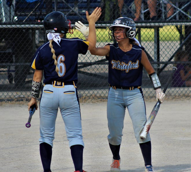 Whiteford's Shaylin Alexander (right) gets a high five from teammate Unity Nelson after scoring against Bridgman in the Division 4 state quarterfinals on Tuesday. An accident nearly made the Bobcats late for the game then a loss ended their season, but none of that wiped the smiles off the faces of the players.