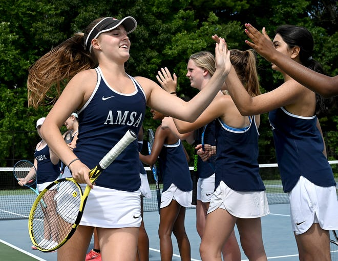 AMSA's Kirstin Hailey high fives her teammates during introductions before a match against Hudson at Assabet Regional High School in Marlborough, June 16, 2021.