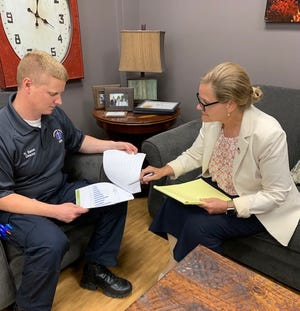 In this photo supplied by Anderson County government, Nathan Sweet, left, county emergency medical services (EMS) director, and County Mayor Terry Frank discuss findings from the 2020 Drug-Related Death Report issued Monday by the Knox County Regional Forensic Center.