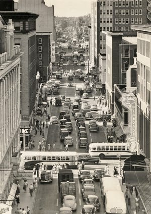 Afternoon traffic along Harvey Avenue is congested on June 17, 1948, as drivers try out the new one-way streets in downtown Oklahoma City. This view is looking north from Sears Roebuck and Co. The new system, which also included one-way traffic southbound on Hudson, had only been in place for five days. Officers expected the traffic headache to lessen as the novelty of the one-way streets wore off and fewer drivers showed up to try out the new plan.
