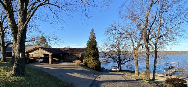 A recent waterfront listing on Grand Lake by RE/MAX Grand Lake broker Jeff Savage: 1501 Carey Drive, Grove, three bedrooms, three baths, 2,673 square feet, $400,000.