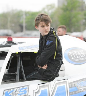 Caden McWhorter looks over his shoulder at Farmer City to watch time trials earlier this season. McWhorter, 14, is a developing driver in the modified class.