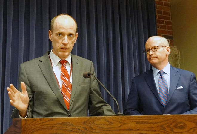 State Sen. Bill Cunningham, D-Chicago, and Senate President Don Harmon, D-Oak Park, speak at a news conference Tuesday night after the chamber failed to bring an energy overhaul bill for a vote. They said they expect a vote to happen sometime this summer as negotiations continue.