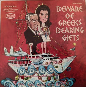 """The 1968 stereo comedy album """"Beware of Greeks Bearing Gifts,""""  parodied the marriage of Greek shipping tycoon Aristotle Onassis to Jacqueline Kennedy.  Artwork by Mort Drucker."""
