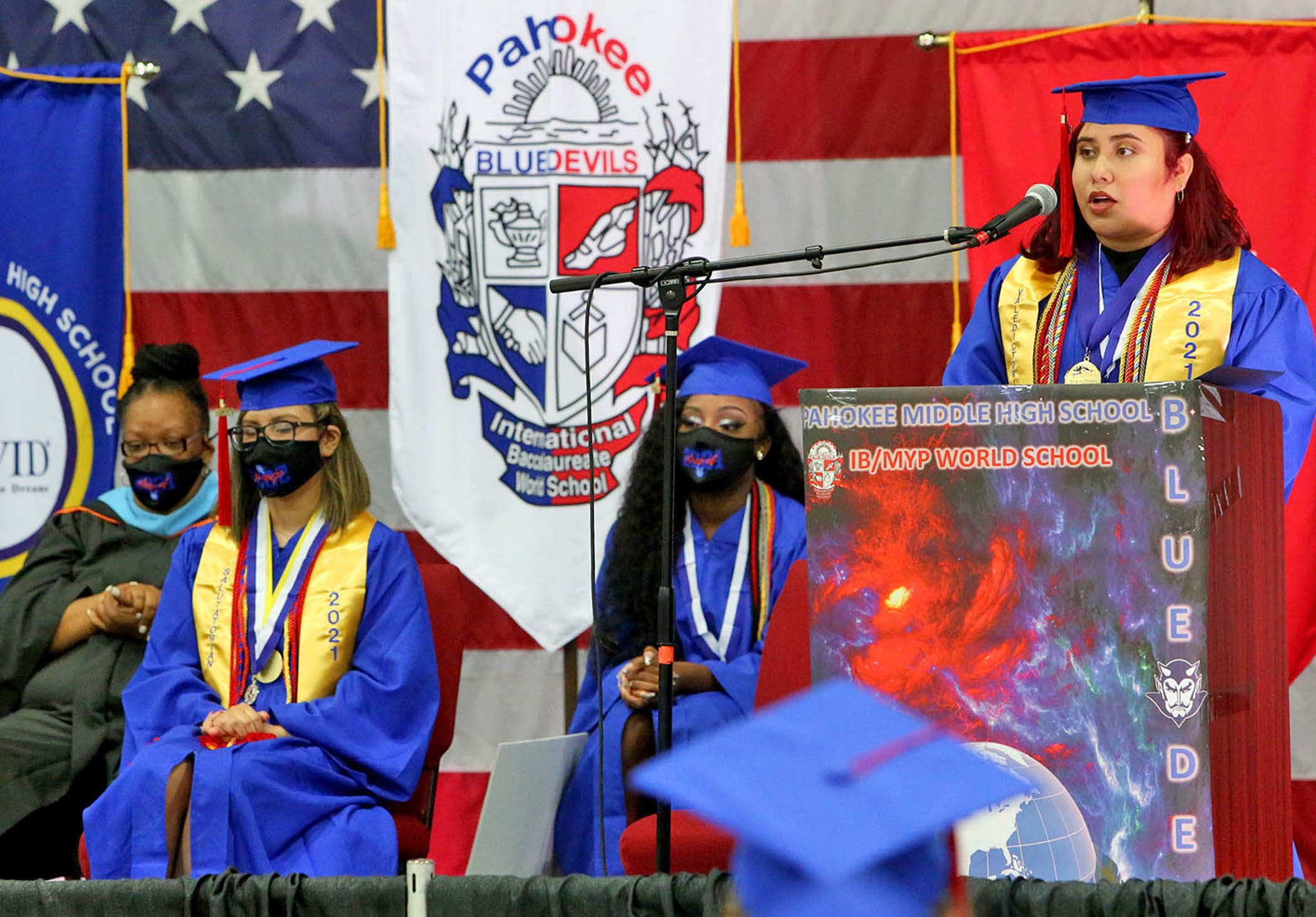 Jasmine Calderon, Pahokee High School's valedictorian, delivers her commencement speech during graduation at the South Florida Fairgrounds.