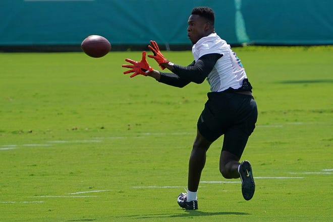 Receiver Allen Hurns, who sat out last season because of COVID concerns, catches a pass during this month's offseason workouts with the Dolphins.