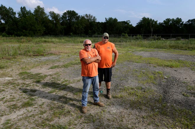 In 2019, John and Derek Read stand in the West Warwick parcel that they own but were unable to use for five years because of a right-of-way dispute.