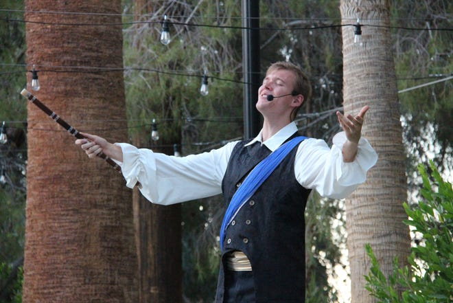 Danny Jensen as Prince Tamino holds the titular Magic Flute in Ridgecrest Opera Workshop's production of the same name.