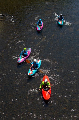 Staff from River House Outdoor Center in Eugene, led by program coordinator Zane Wheeler, bottom, float down the Willamette River near Springfield on Wednesday during a training session in anticipation of the summer season. For more information about programs, visit eugene-or.gov/749/Outdoor.