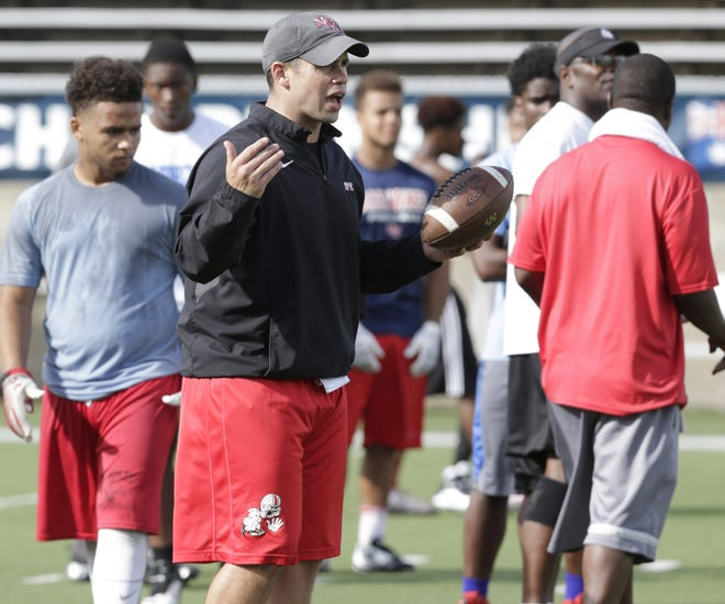 Josh Grimsley, shown here in a 2015 photo, has been an assistant football coach at McKinley High School for more than 15 years.