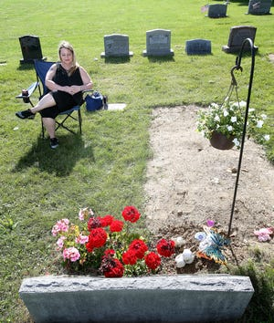 Annette France visits with her late mother daily at Oakwood Cemetery in Massillon. Sally Rohelig died unexpectedly in April, and France likes leaves gifts when she visits.