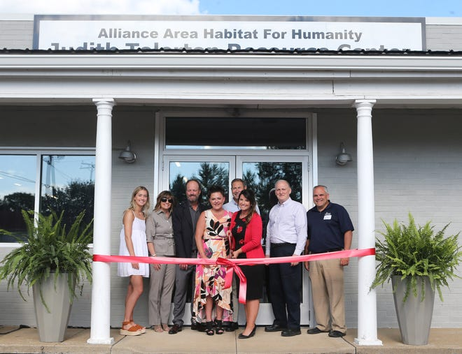 The ribbon is cut for the Alliance Area Habitat for Humanity / Judith Tolerton Resource Center in Alliance on Tuesday, June 15, 2021. From left are Kylie Tolerton, Marci Tolerton, Will Tolerton, Megan Riordan, Restore manager, Gerard Mastroianni, Greater Alliance Foundation, Niky McIlvain, executive director of Habitat, Joe Mazzola, planning director for the city of Alliance and Joe Laure, general contractor. The center was named in honor of Will's mother Judith.