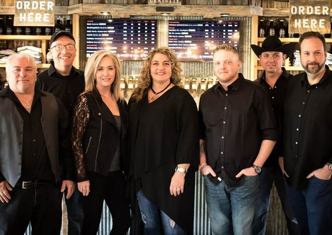 Bigg Country members Rich Morpurgo, Rob Helms, Mona Skirvin, KJ Denton, Aaron Glenn, Aaron Lanane and Kirby Jarvis pose for a photo. The band will open for Justin Moore at this year's Morgan County Pre-Fair Country Concert.