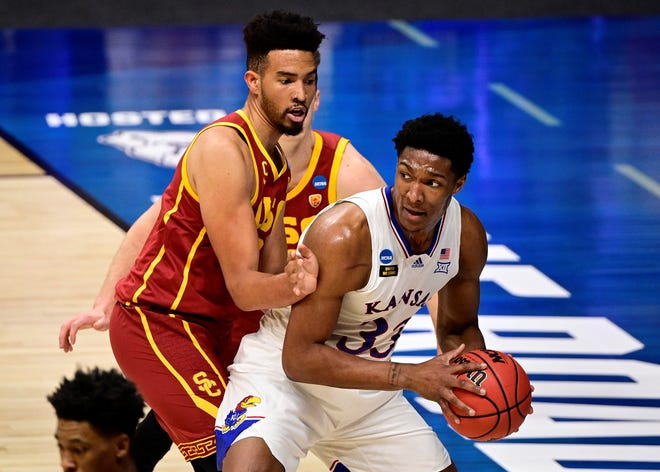Kansas  forward David McCormack (33) looks to pass against Southern California's Isaiah Mobley (3) during a March 22 NCAA Tournament game in Indianapolis.