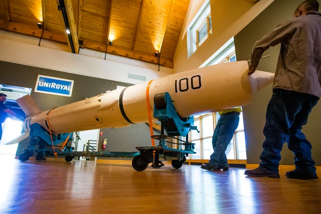 Crews work to move a Talos Missile in place Wednesday, June 16, 2021 at The History Museum in South Bend.