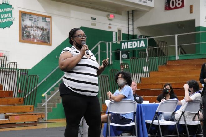 South Bend mother Komaneach Wheeler Brown calls on city leaders and community activists to come together in a public meeting Tuesday night at Washington High School to discuss the role of school resource officers.
