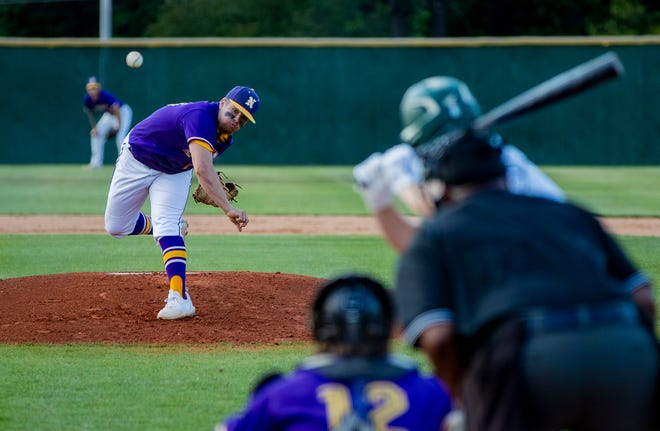 North Henderson Knights junior pitcher Dylan Blackwell throws against the Crest Chargers Tuesday afternoon in Shelby N.C. in the first round of the NCHSAA playoffs. The Knights defeated the Chargers 6-3.
