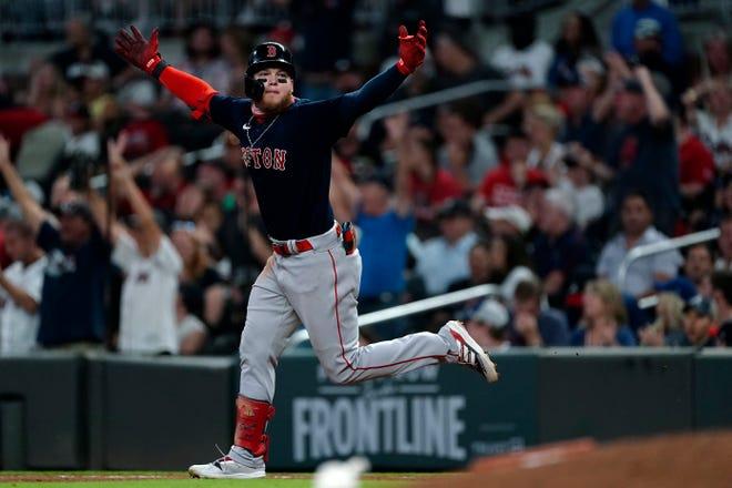 Boston Red Sox's Alex Verdugo celebrates as he runs the bases on a three-run home run against the Atlanta Braves on Tuesday in Atlanta.