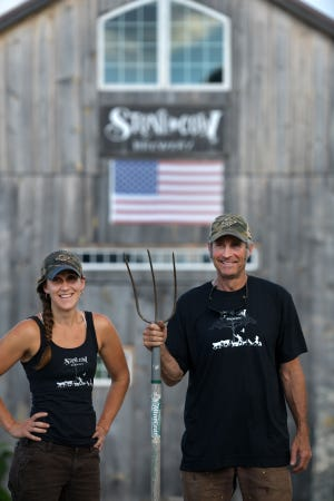"""In a nod to Grant Wood's """"American Gothic,"""" Molly Stevens Dubois and her father, Phil Stevens, put their own spin on the classic painting Tuesday at Stone Cow Brewery in Barre."""