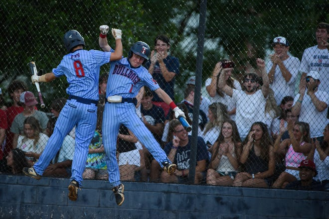 Terry Sanford's Brent Smith and Hunter Wiggins celebrate after Smith scored against Union Pines in the first round of the NCHSAA baseball playoffs on Tuesday, June 15, 2021.