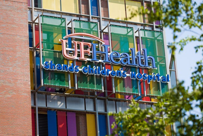 The UF Health Shands Children's Hospital logo stands out against the colorful medical building. (Photo courtesy of UF Health)