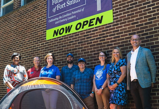 Future School of Fort Smith received a grant from the Arvest Foundation that will help support the school's summer outdoor program. Pictured (from left): Tammy Roper and Roger Holroyd of Arvest Bank; Allison Montiel,  Shannon Wiley, Brett Roberts and April Moore of Future School; Beth Presley of Arvest Bank; and Boyd Logan of Future School.