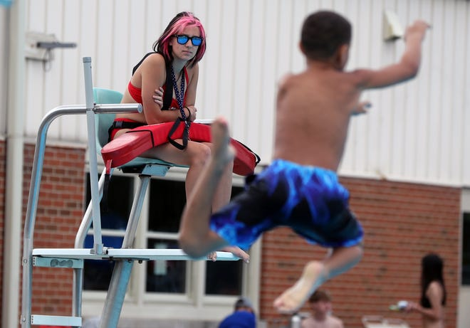 Lifeguard Emma Stevenson, 15, keeps an eye on children diving into the pool June 15 at Worthington Pools.
