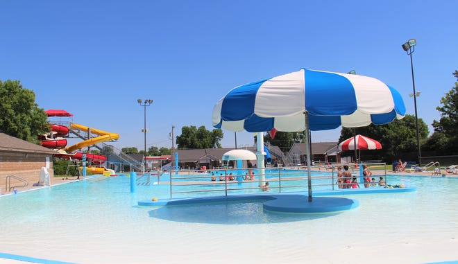 People enjoying the Wellington Family Aquatic Center on a hot summer day