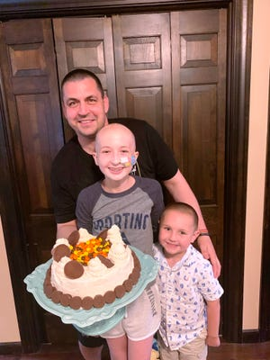 Malia Jusczyk, 13, of Plainville is a contender in an online baking contest — the winner is determined by votes from the public. Votes will be accepted until 7 p.m. today. She is pictured here with her dad, Glen, and little brother, Kole. She made the cake for her dad's birthday.