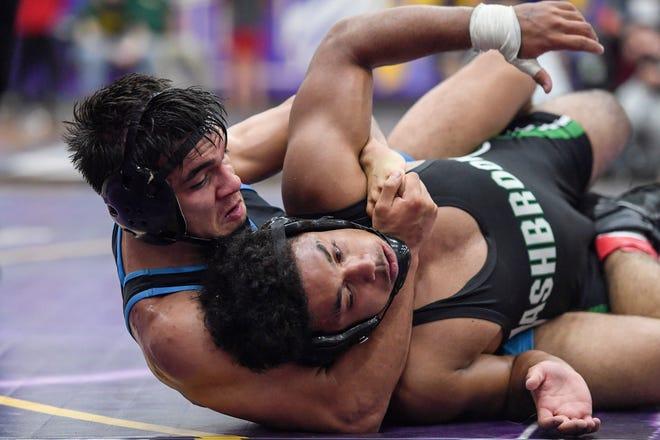 Enka's Tony Torres, left, defeated Ashbrook's Elijah Antis in the NCHSAA 3A West Regional 160 final June 15, 2021.