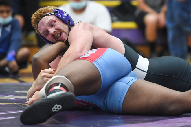 North Henderson's Triston Norris works to pin North Iredell's Elijah Hurt to place first in the NCHSAA 3A West Regional 220 final June 15, 2021.