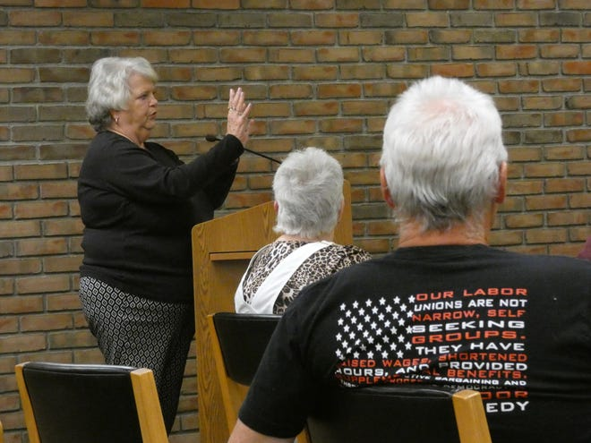 Carolyn Shireman, center, and Dan Wirebaugh, right, listen as Deb Pinion addresses members of Bucyrus City Council on Tuesday. Pinion sought support for a plan to restore three crosses on Ohio 4 south of the city.