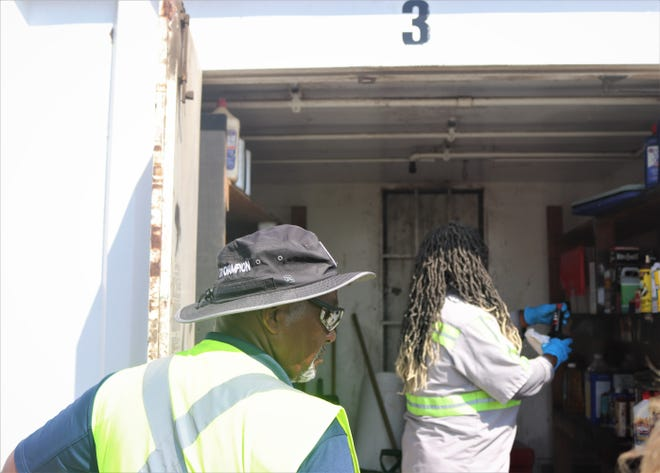 Workers dispose of  waste at Household Hazardous  Disposal Area at J.C Elliott Transfer and Collection Center.