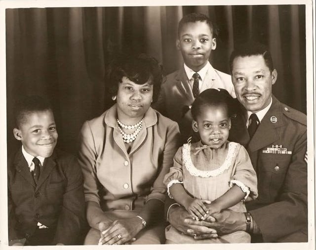 Robert J. Robinson poses with his wife, Anne Wilson Robinson, and their children Vincent, Robert Jr. and Adrienne in 1968 before the family moved to Japan.