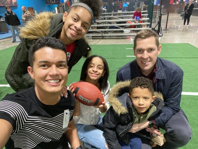 Reinaldo Barbosa and Brian Bartal photographed with their children Nadia, 16, Brooklynn, 14, and Lorenzo, 6.
