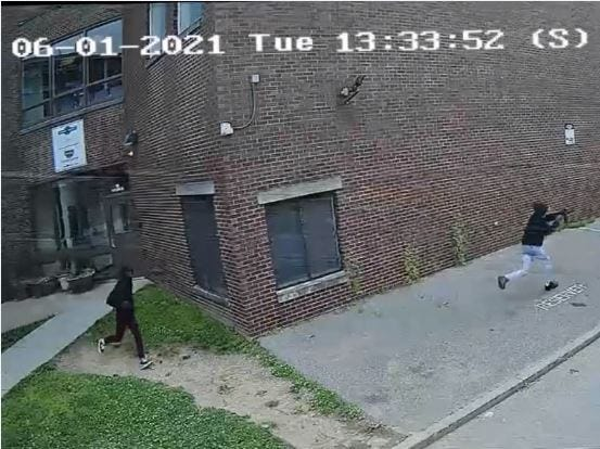 A screen capture of a surveillance video shared with Cincinnati police from Our Daily Bread shows two people running with guns drawn down Goose Alley in Over-the-Rhine June 1 where two people were shot by gunman, police said.