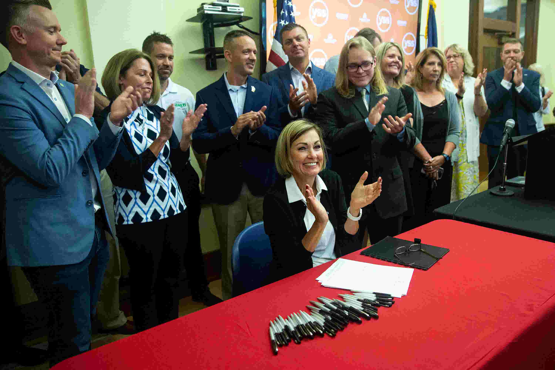 Iowa Gov. Kim Reynolds signs sweeping tax cut law