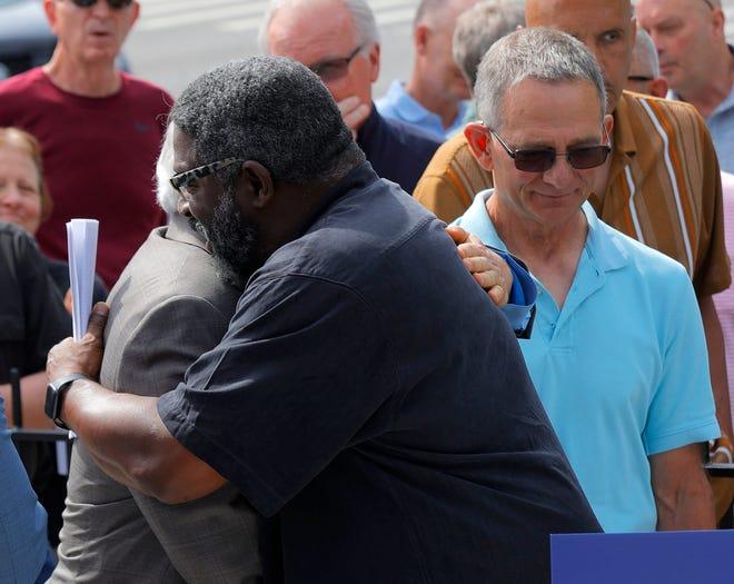 Jon Vaughn hugged Richard Goldman after a news conference Wednesday.
